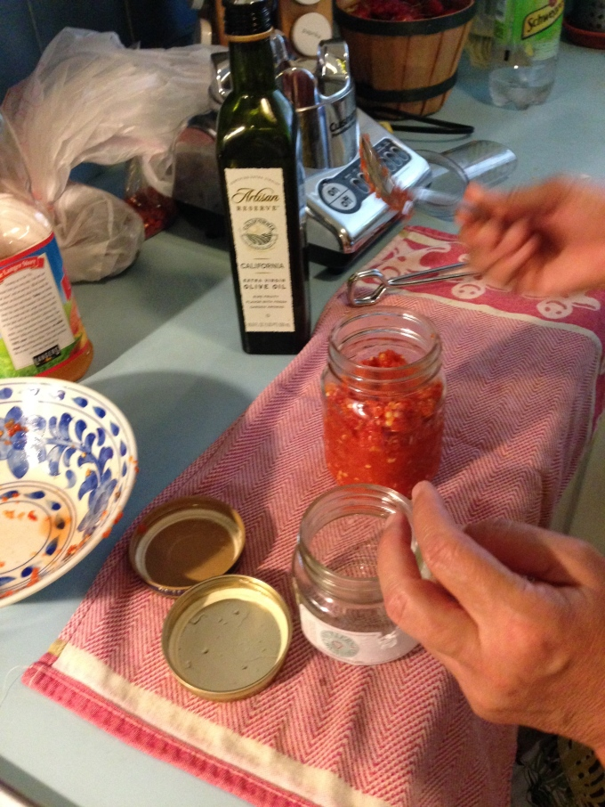 step 13. carefully spoon the mixture into the sterilized jar(s)